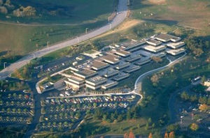 Aerial view of the Palo Alto Research Center (PARC). Note the vast space dedicated to free parking. Ironic, huh?