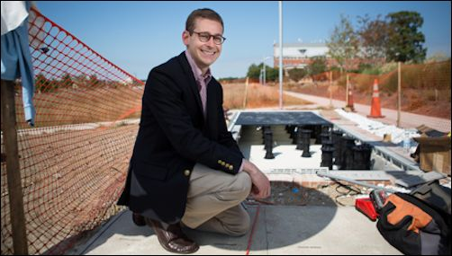 Senior Land Use Planner Eric Selbst at the site of the walkable solar paneled pathway. Photo credit: GWU.