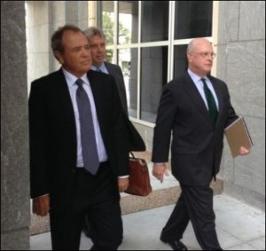 Jonnie Williams (left), the prosecution's star witness, makes his appearance at the  federal courthouse.