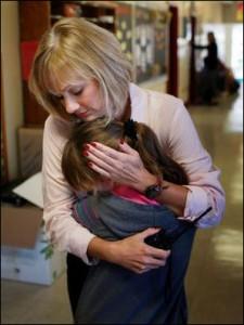 Highland View Principal Pam Smith dispenses a hug.