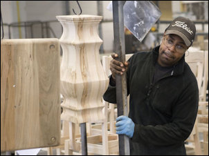 Tim Hairston, laid off in 2007 when Bassett Furniture shut down a factory, has regained employment at the company's new Bench Made facility. Photo credit: Roanoke Times.